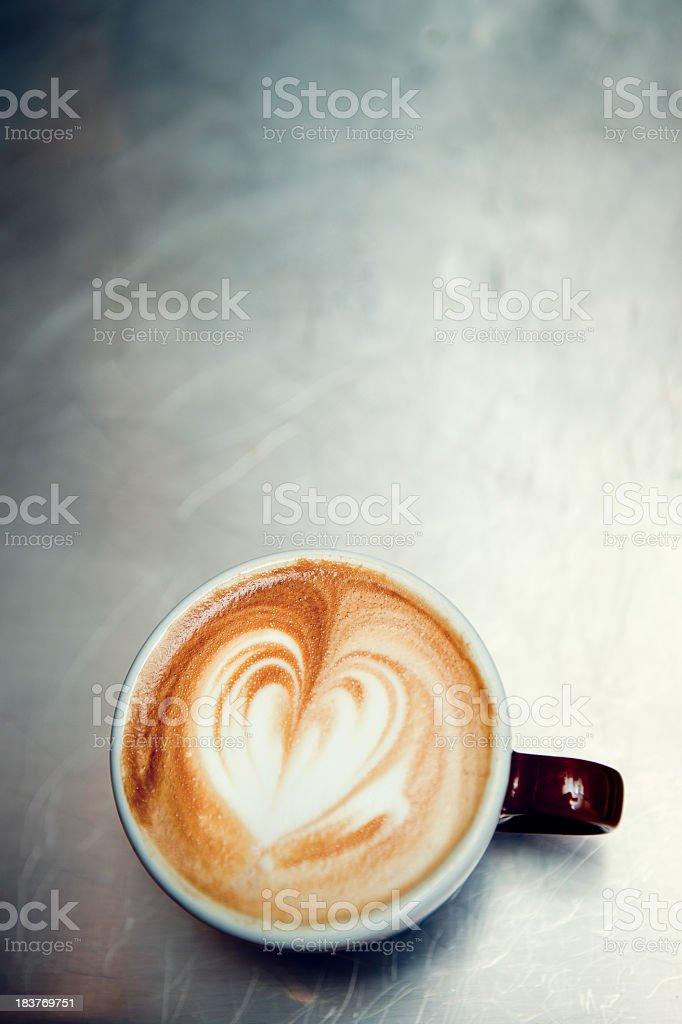 Caffe Macchiato Heart Shape on Brushed Steel royalty-free stock photo