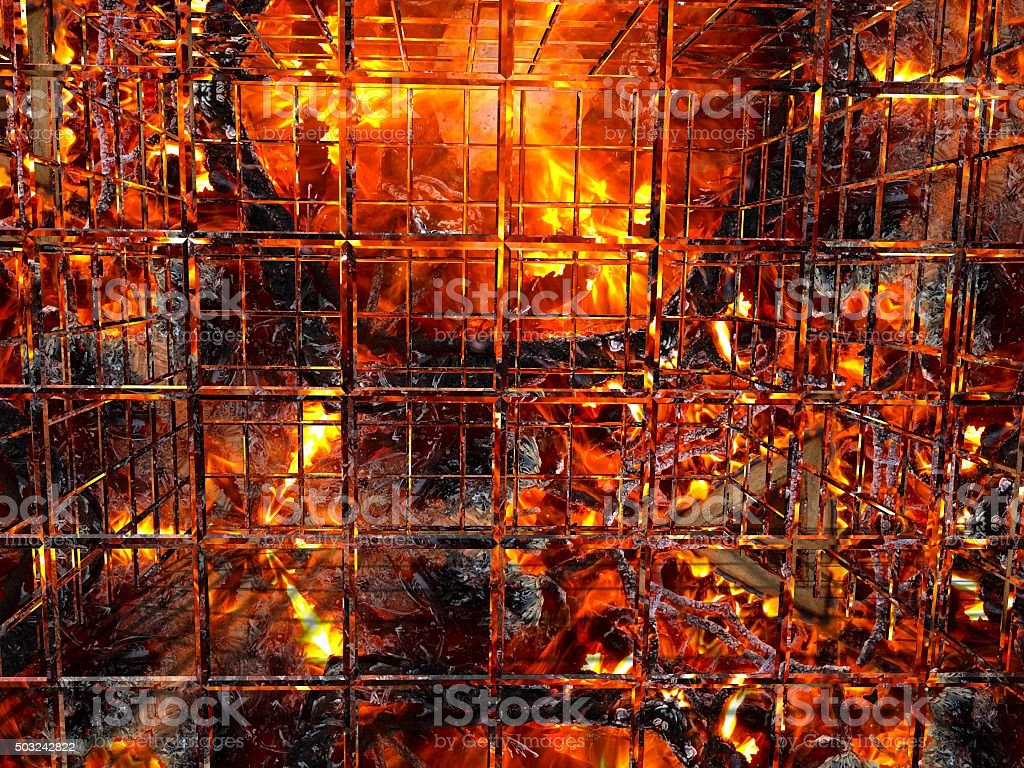 Cage of fire over furnaces of hell stock photo