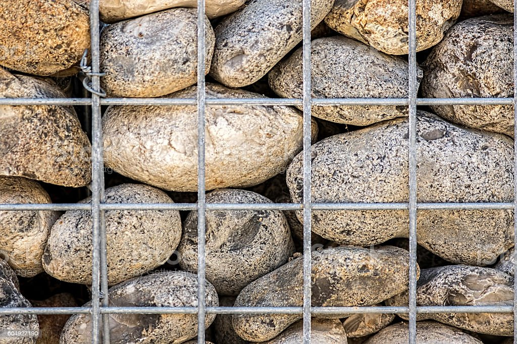 Caged stones abstract pattern stock photo