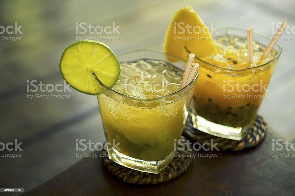 Caipirinha Two Traditional Brazilian Cocktails with Fresh Fruit stock photo