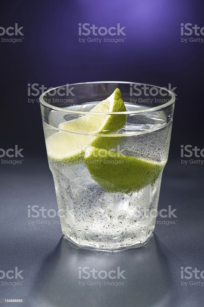Caipiroska cocktail nice decorated in front of a colored background royalty-free stock photo