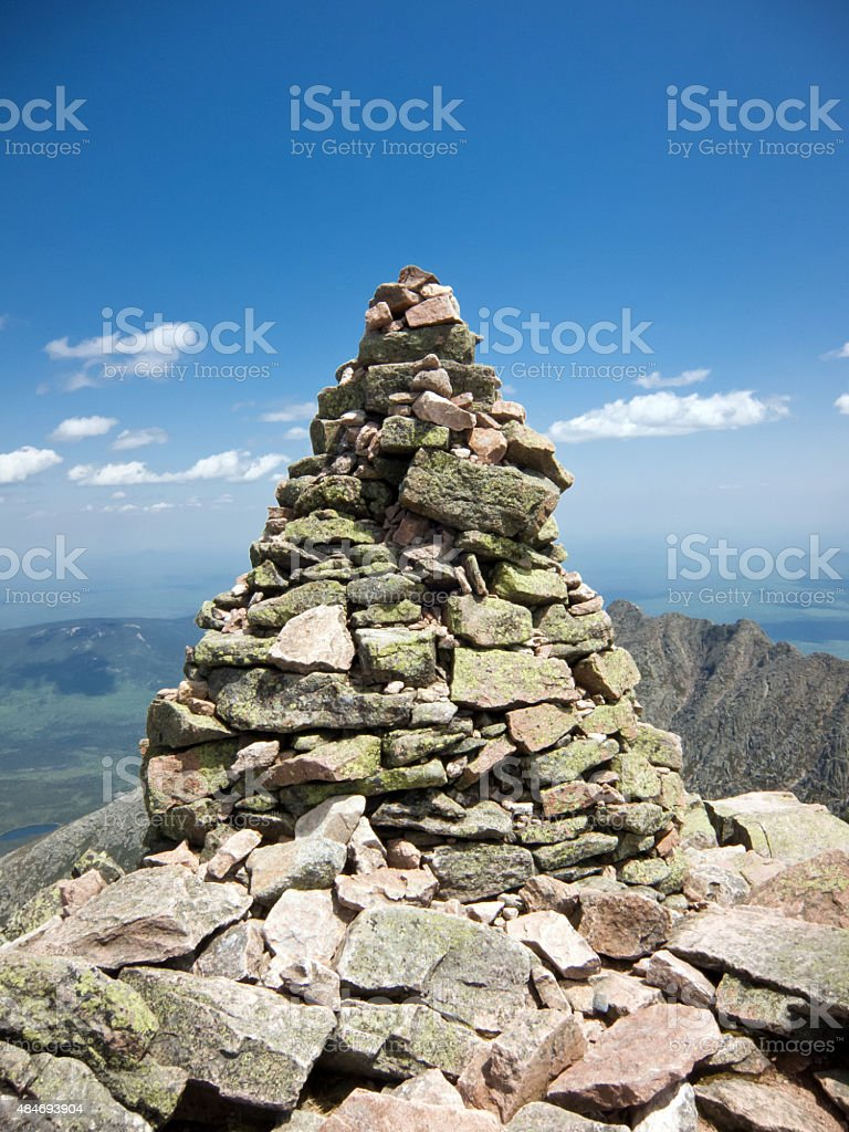 Cairn at a mountain peak stock photo