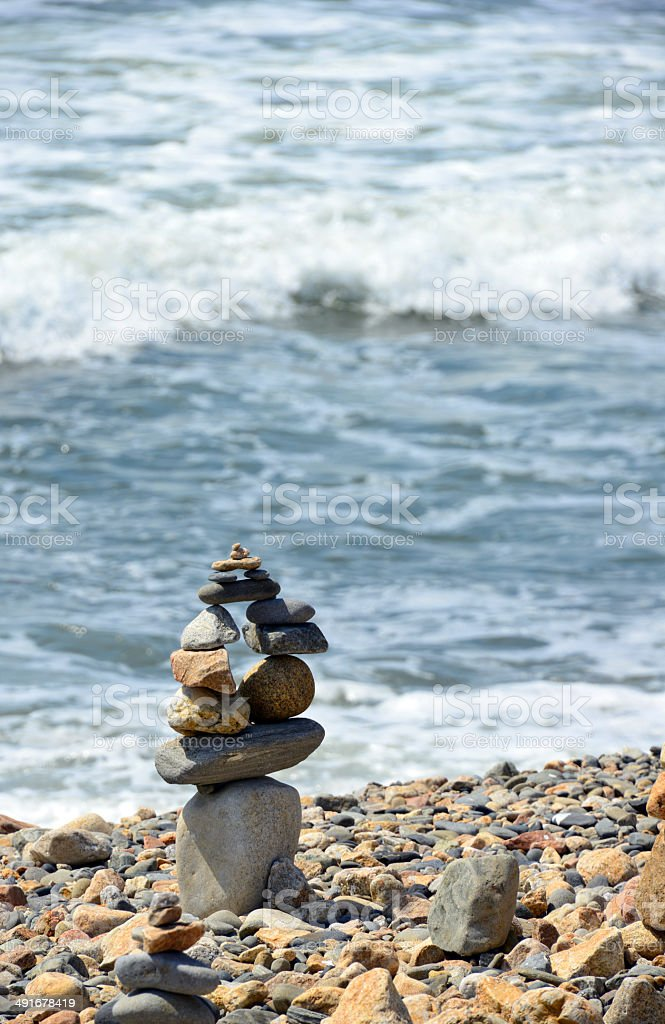 cairn by the sea stock photo