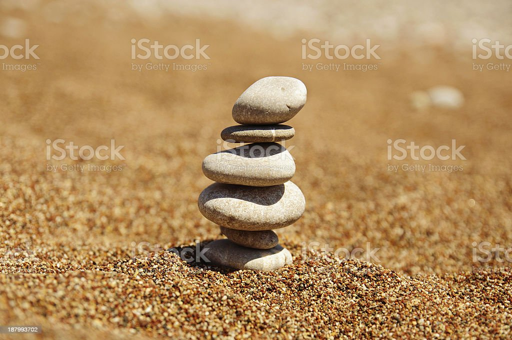 Cairn on the sand stock photo