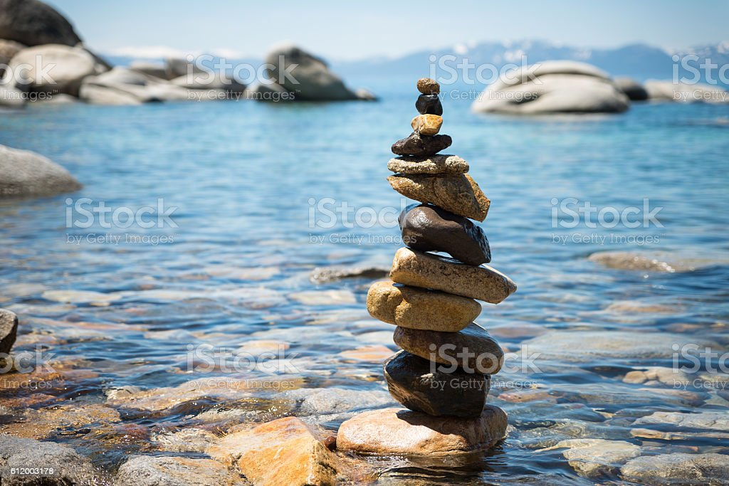 Cairn pyramid on lake Tahoe shore stock photo