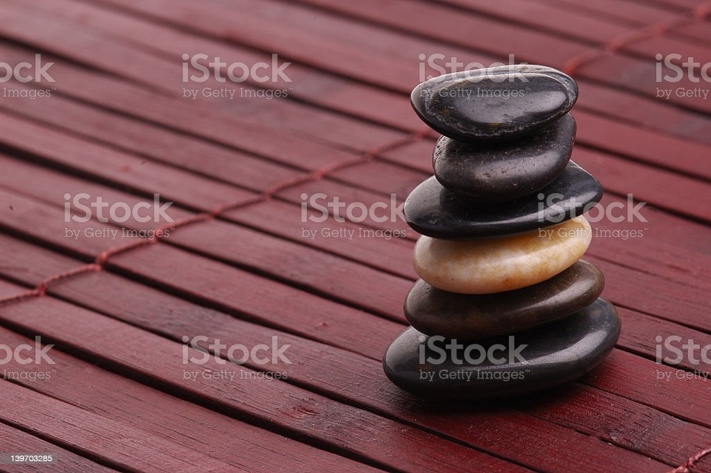 Cairn stones stacked in a set of six royalty-free stock photo