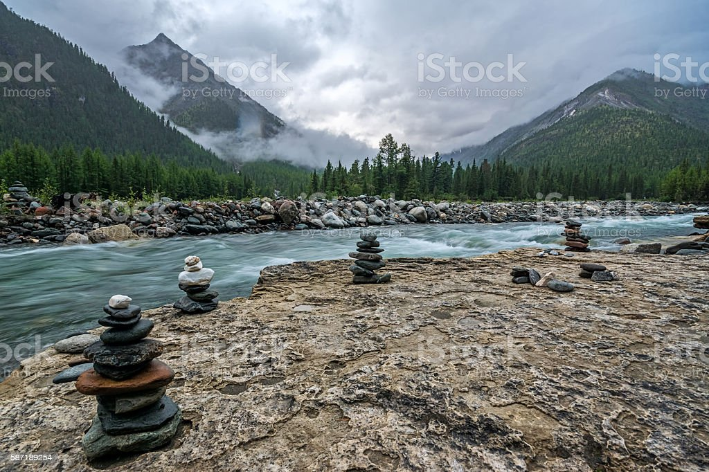 Cairns on the bank of river Shumak stock photo