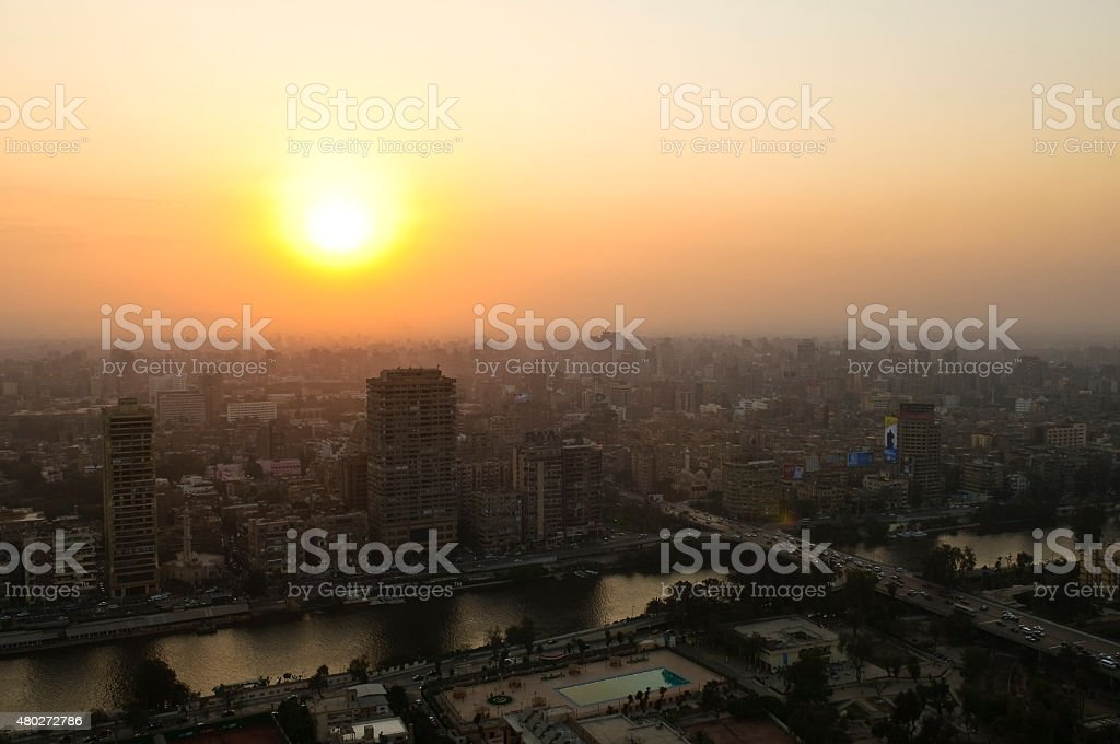 Cairo Egypt skyline and Nile River at sunset stock photo