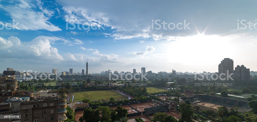 Cairo skyline and sun flare stock photo