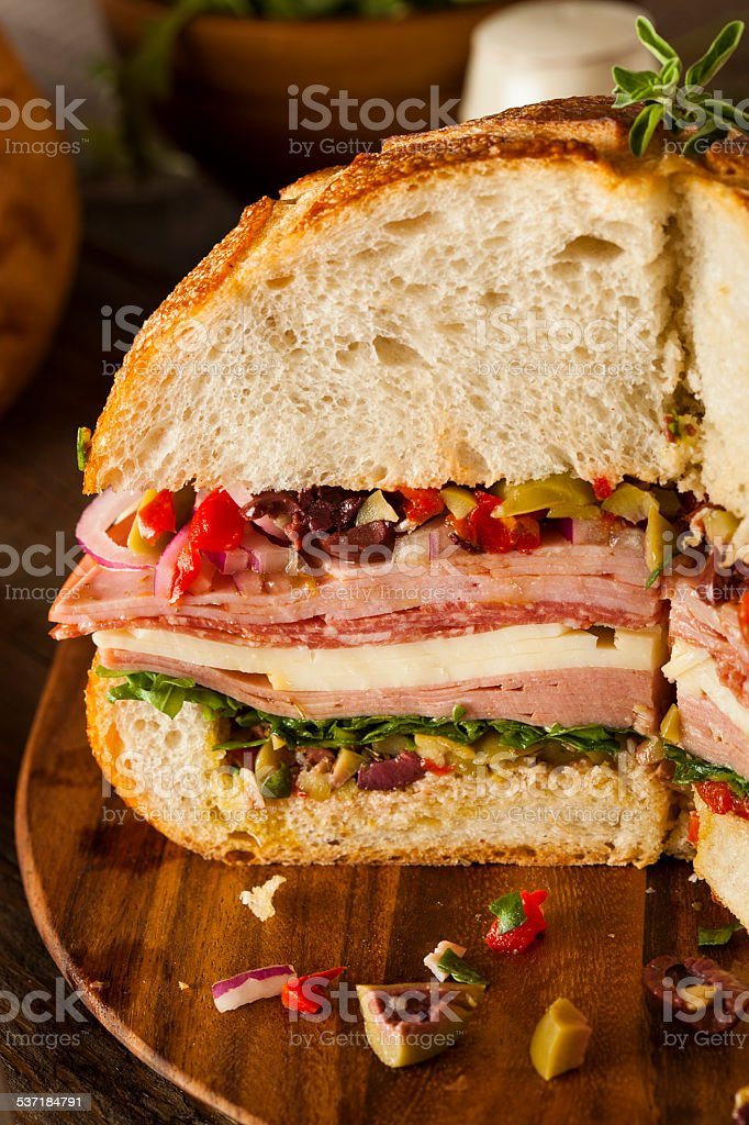 Cajun Muffaletta Sandwich with Meat and Cheese stock photo