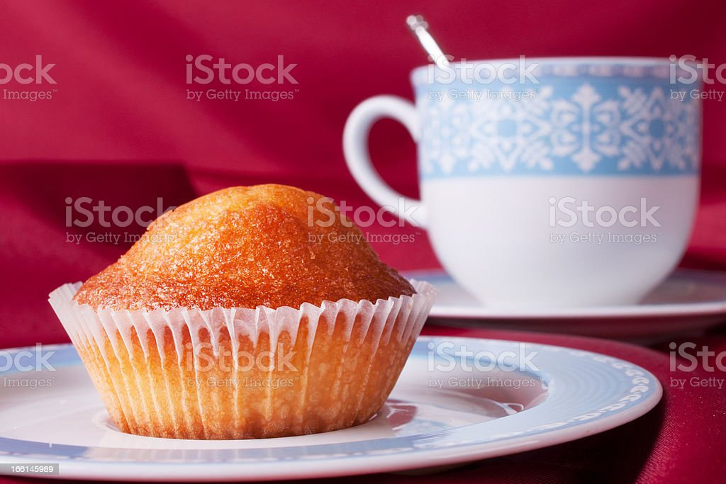Cake and blue tea cup royalty-free stock photo