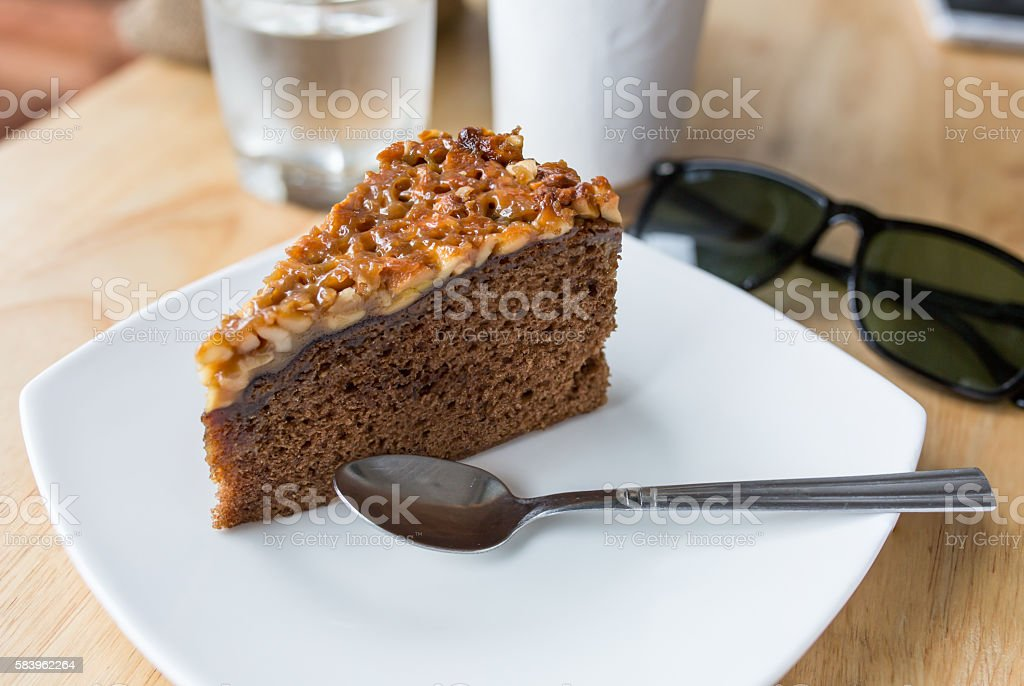 cake and coffee cup on wood table stock photo