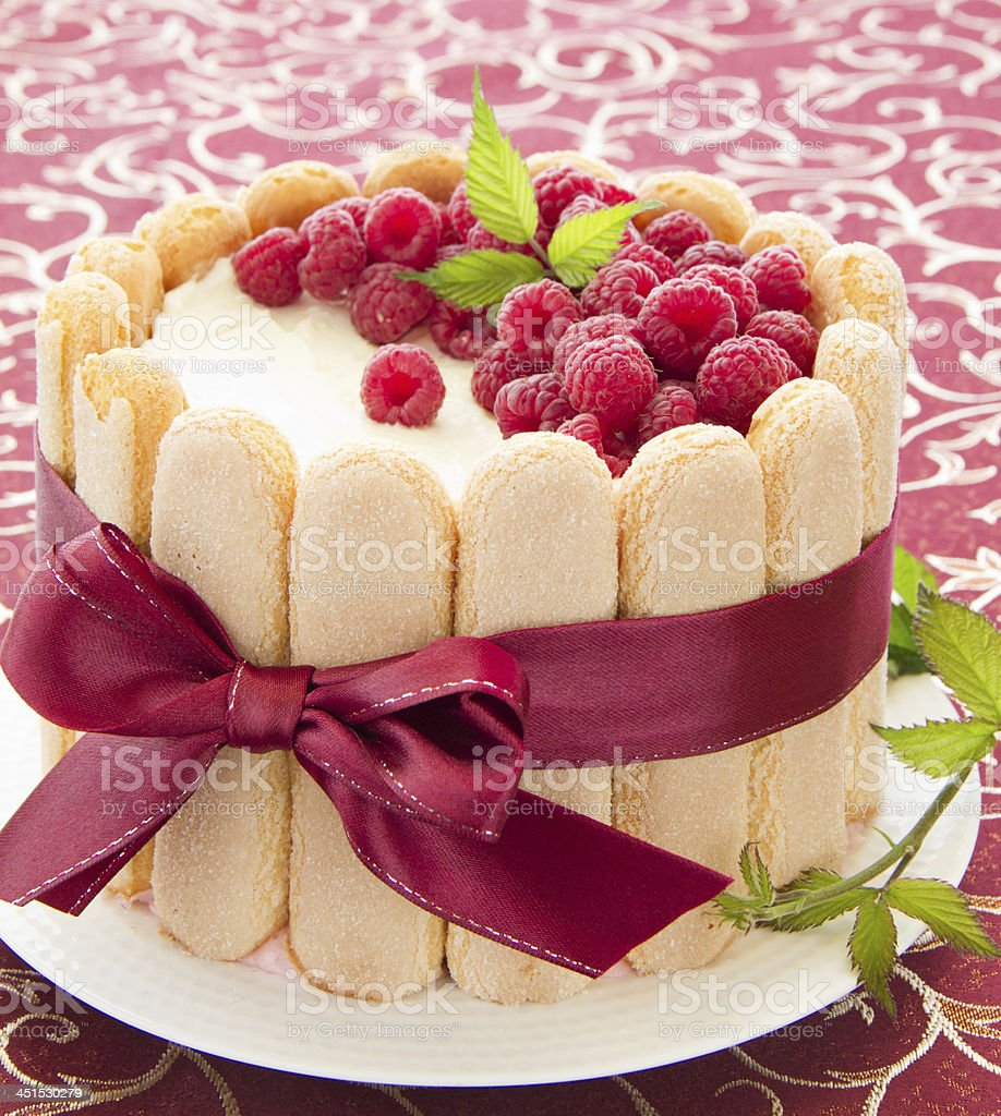 Cake 'Charlotte' with raspberries and cream, selective focus. stock photo