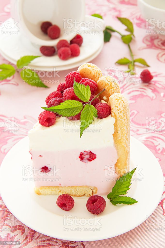 Cake 'Charlotte' with raspberries and cream, selective focus. royalty-free stock photo