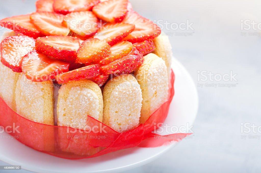 Cake 'Charlotte' with strawberries stock photo