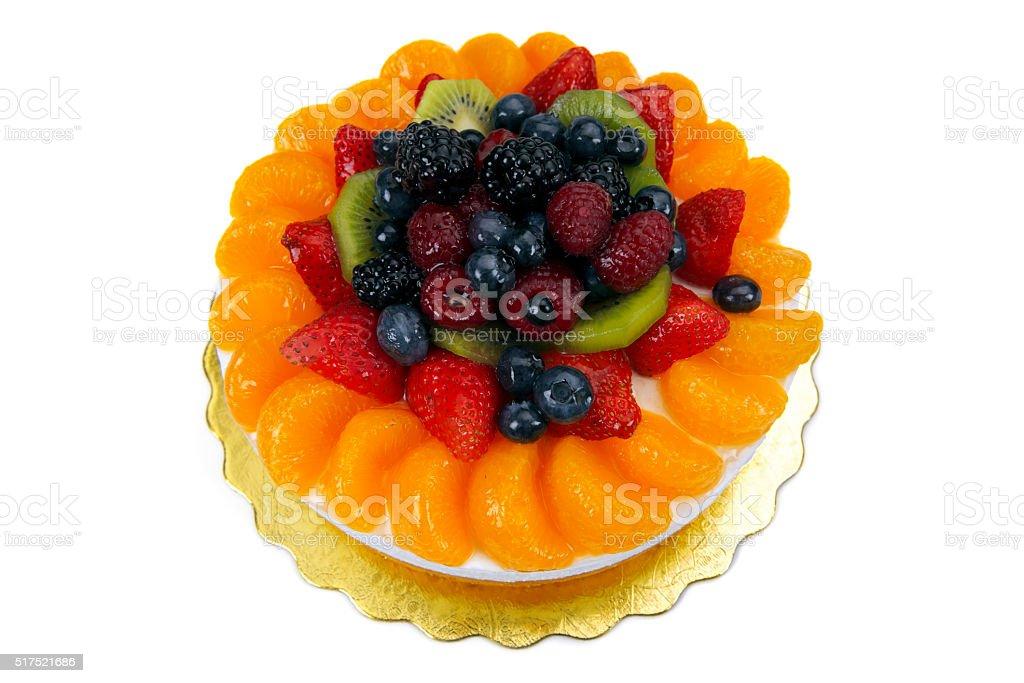 cake decorated with fresh fruit stock photo