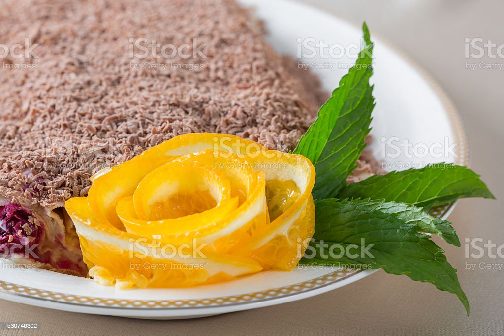 Cake decorated with sliced orange and mint stock photo