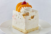 Cake dessert with peach and cherry