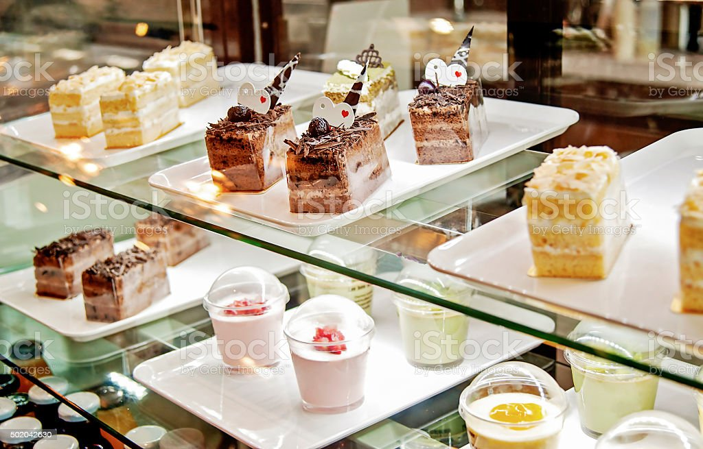 Cake displayed in shop window of confectionery or cafe stock photo