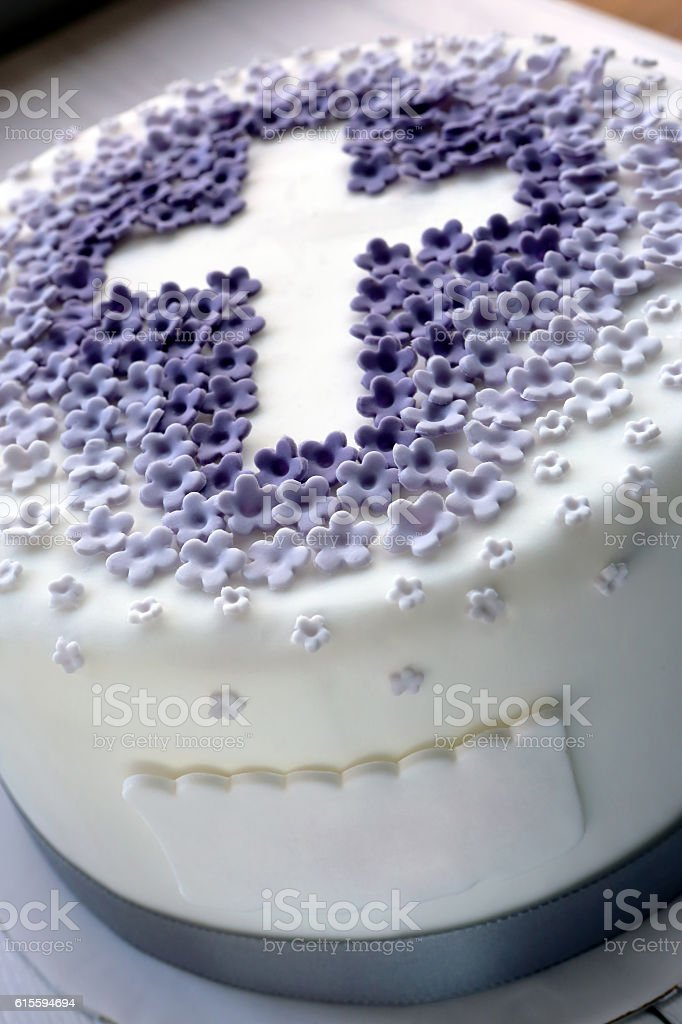 Cake for the first holy communion with cross stock photo