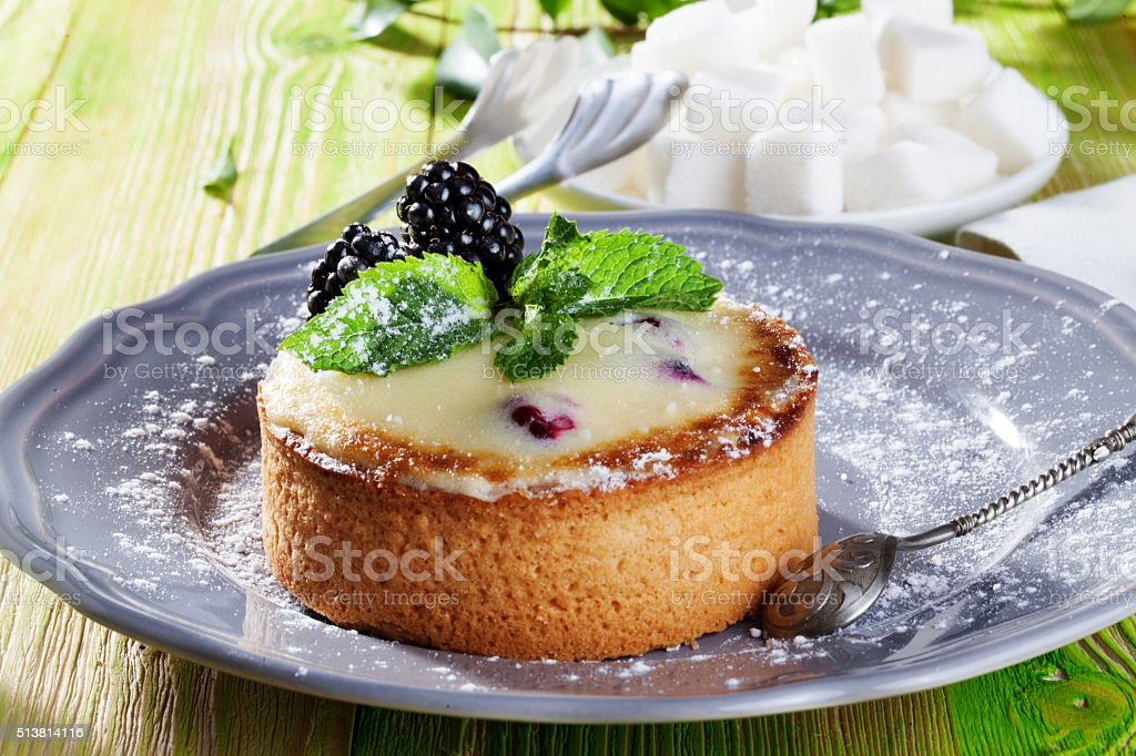 cake of semolina blackberries, winter, holiday and mint on a stock photo
