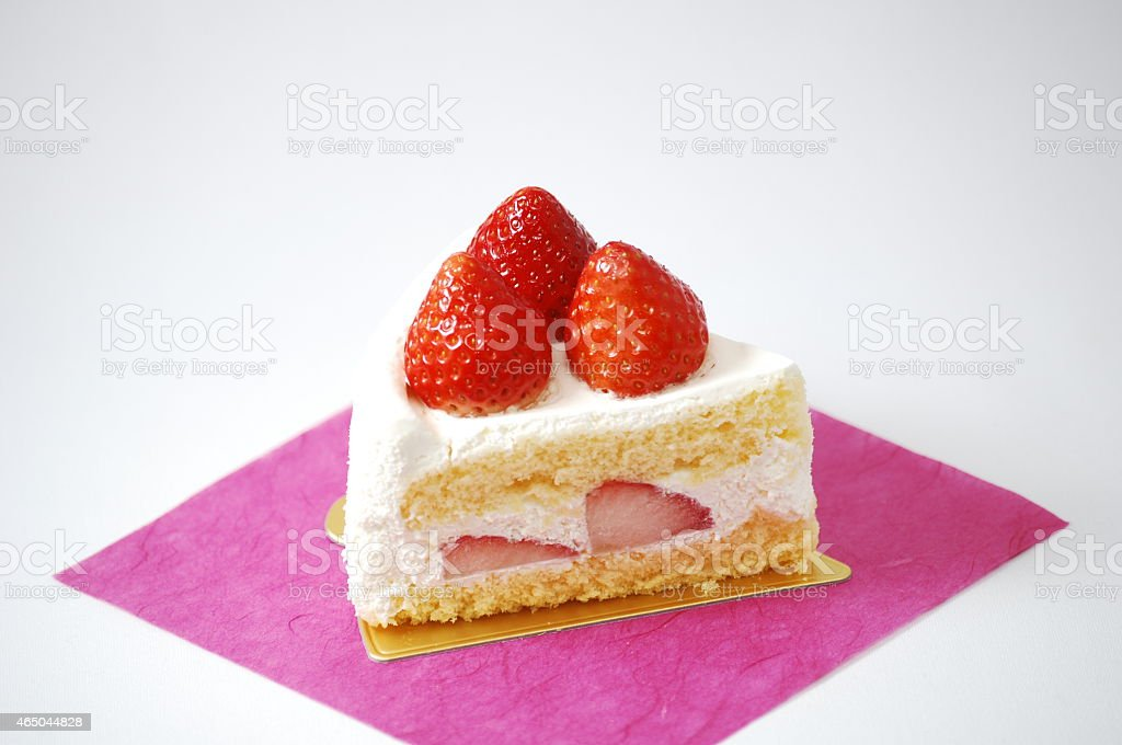 Cake of three pretty strawberries. stock photo
