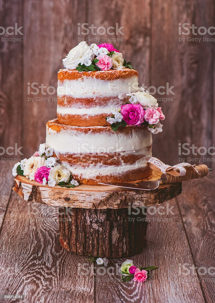 Cake on a wooden cut stand stock photo