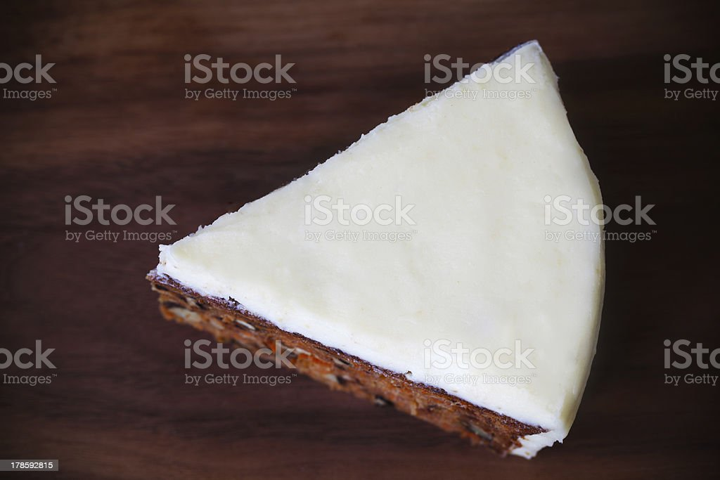Cake piece portion with white cream cheese icing, macro royalty-free stock photo