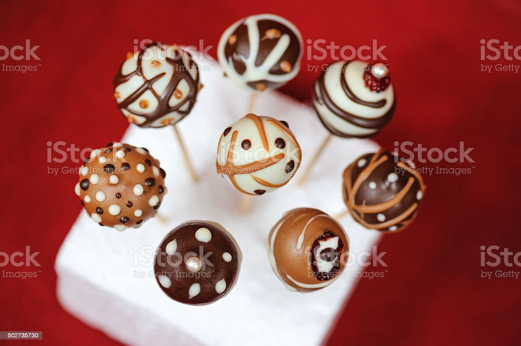 Cake pops, modern chocolate candy stock photo