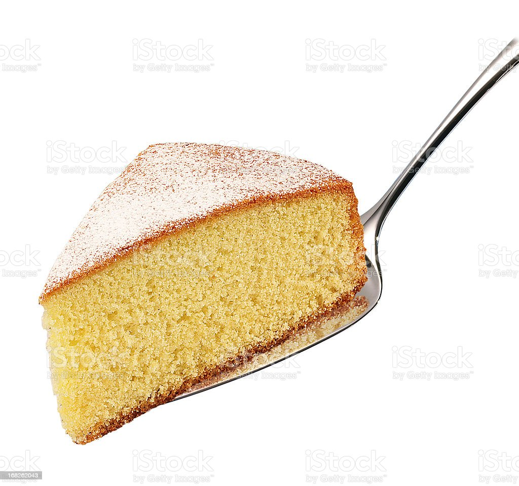 A cake slice on a silver spoon stock photo