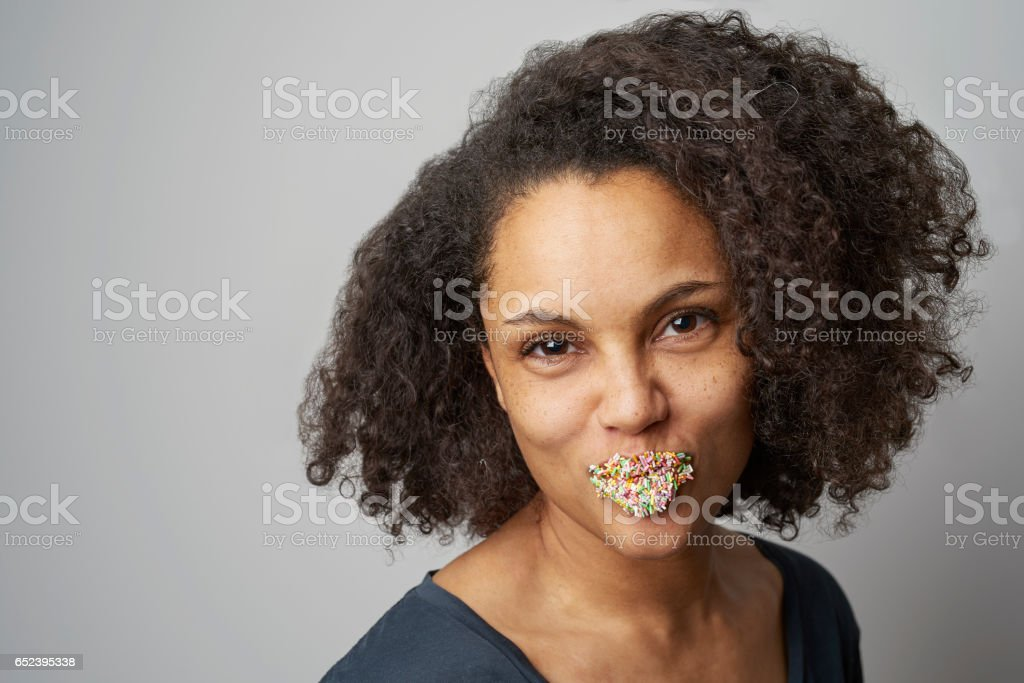 Cake sprinkles on lips stock photo
