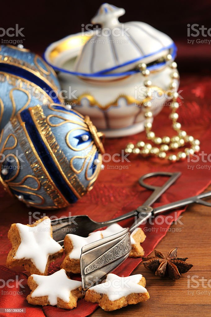 Cake tong with Biedermeier porcelain and old Christmas ornaments stock photo