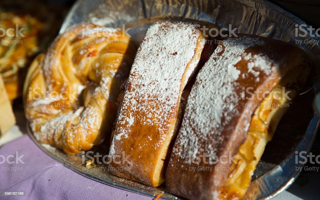 Cake vertically in the window consists of 3 parts stock photo