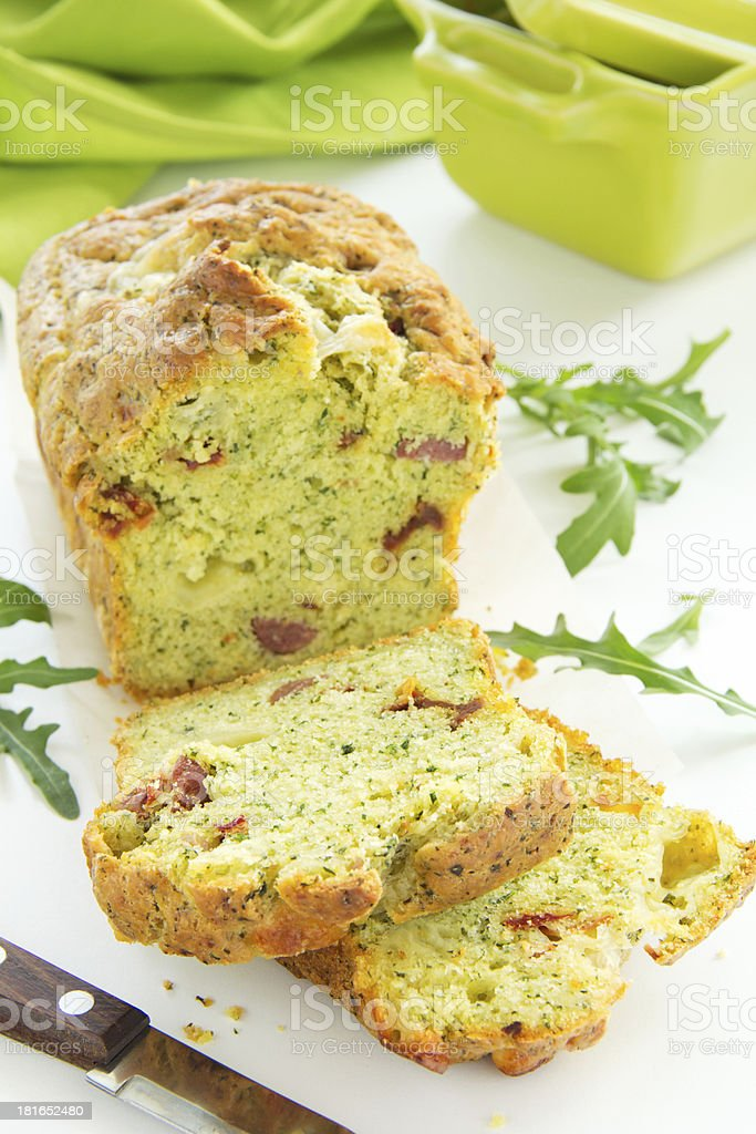 Cake with arugula, pesto, tomatoes and chorizo​​. royalty-free stock photo