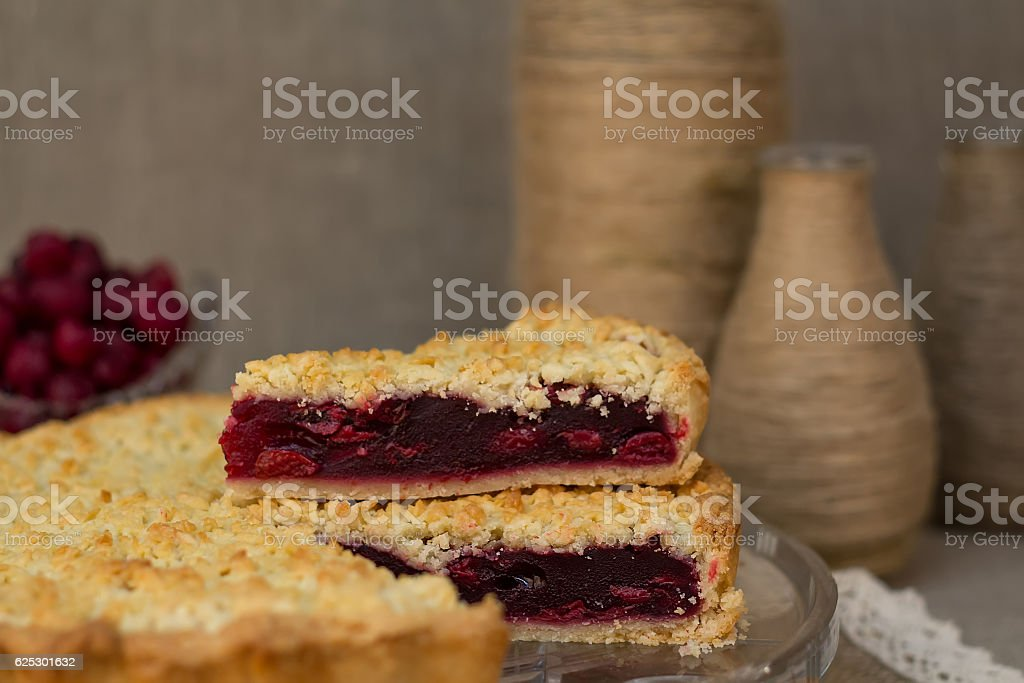 cake with cherry filling in the background vases and burlap stock photo