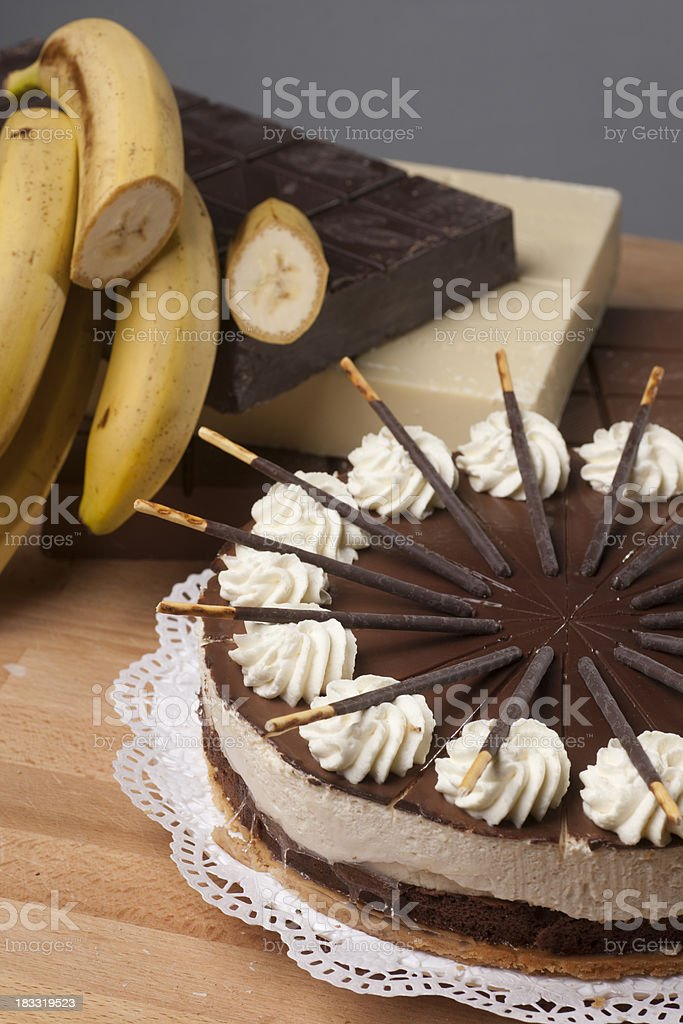 Cake with chocolate and bananas royalty-free stock photo