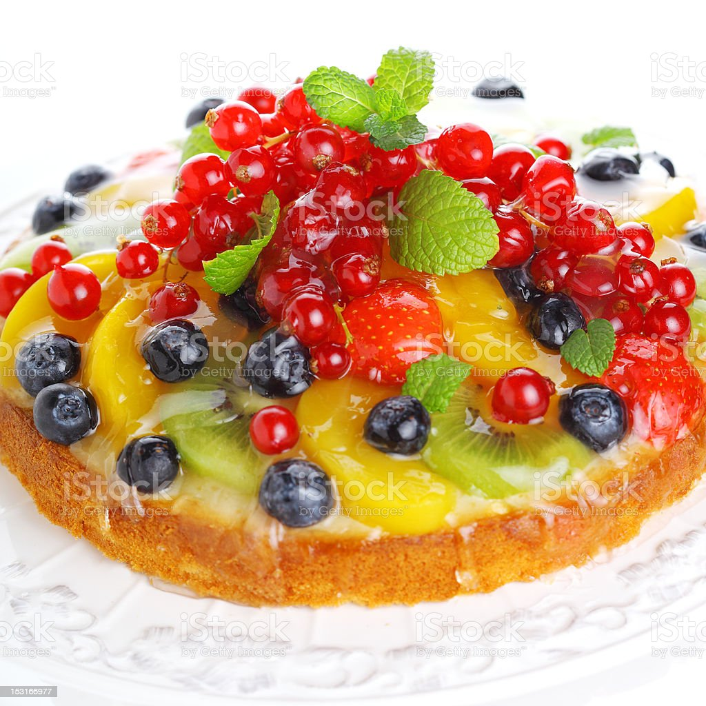 cake with fresh berries and fruit isolated on white background royalty-free stock photo
