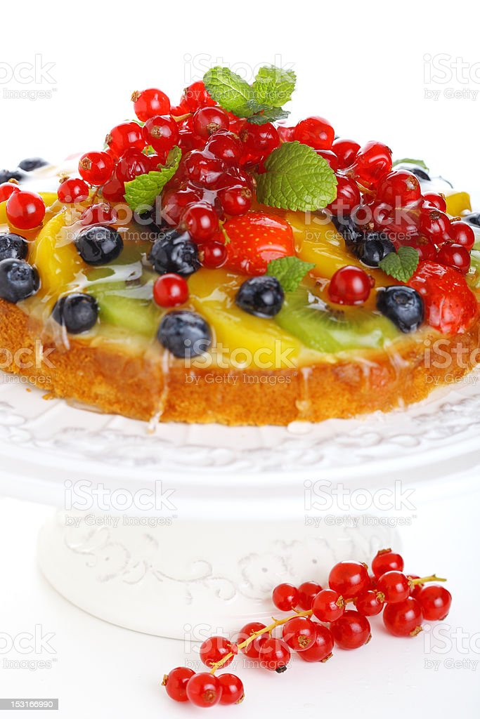 cake with fresh berries and fruit isolated on white background stock photo