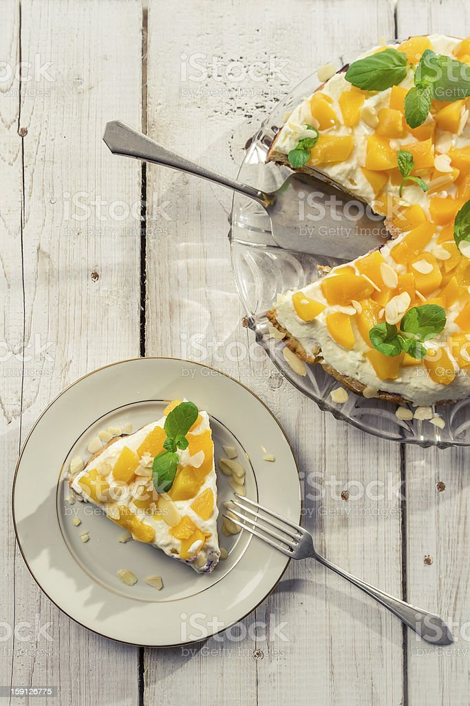 Cake with peaches and almonds on a plate royalty-free stock photo
