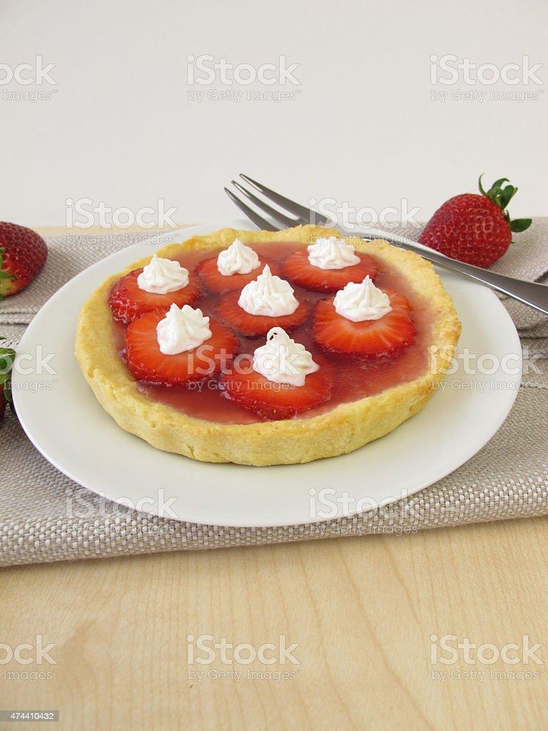 Cake with strawberries and sugar cream decoration stock photo