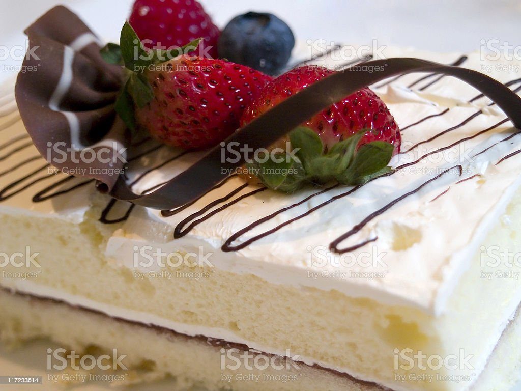 Cake with strawberry blueberry and chocolate on top royalty-free stock photo