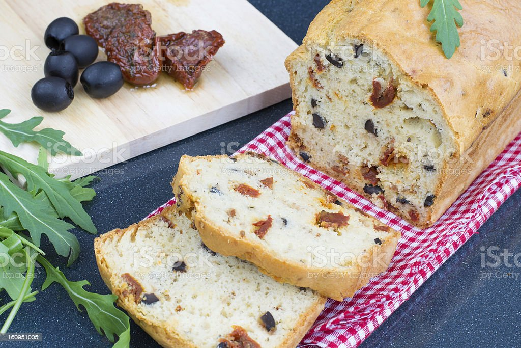 Cake with sun-dried tomatoes and black olives royalty-free stock photo