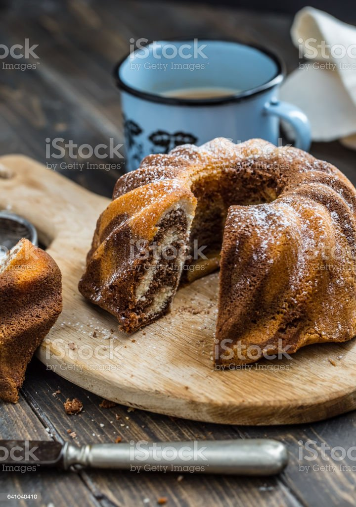 Cake.Marble cake cup of coffee powder sugar kitchen vintage utensil. stock photo