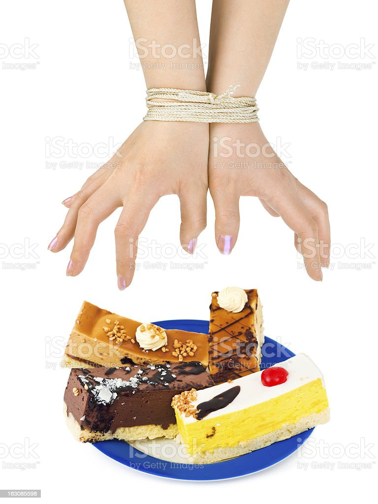Cakes and bound hands royalty-free stock photo