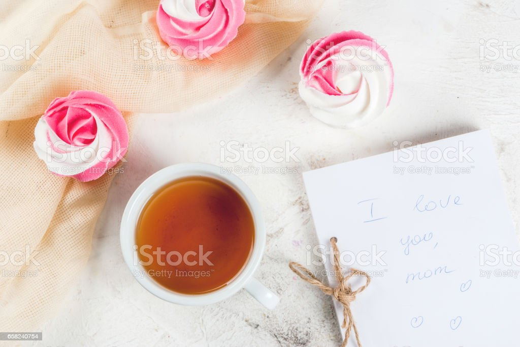 Cakes in the form of flowers and tea stock photo