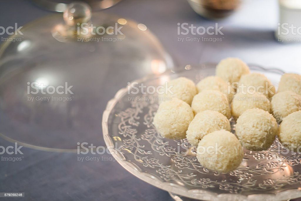 Cakes with coconut truffles in the evening light on stock photo
