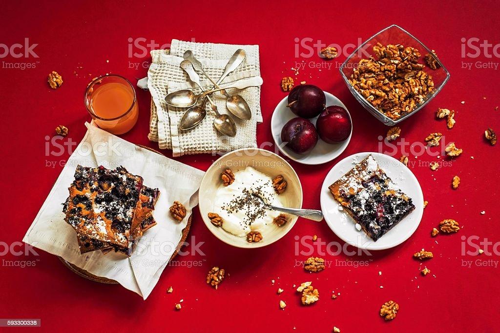 Cake,yogurt,nut and fuice on many plates stock photo