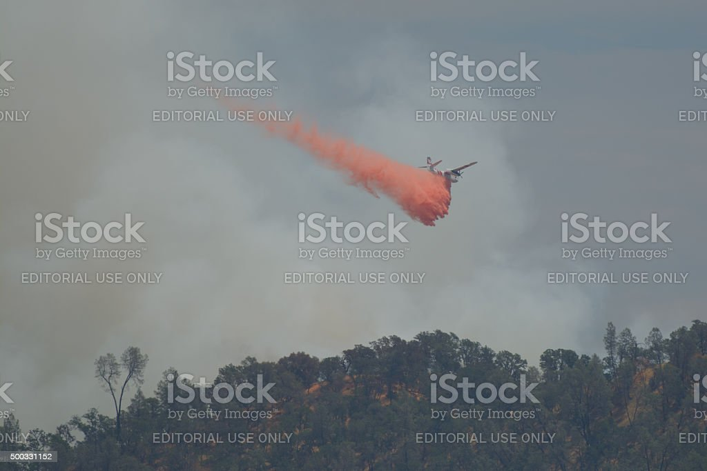 Cal Fire Plane spraying  Fire stock photo