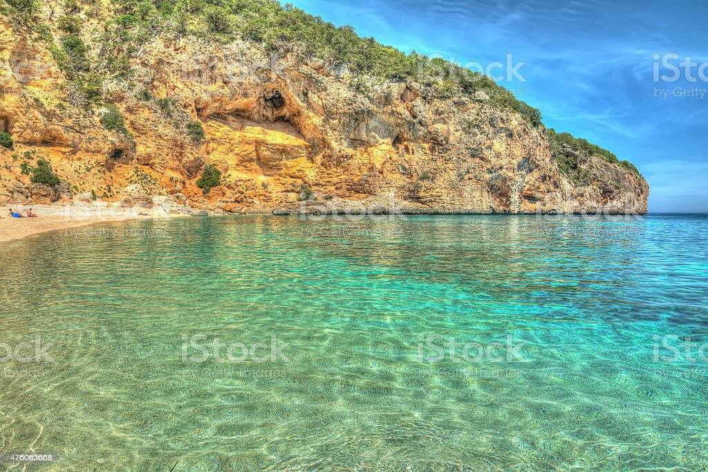 Cala Biriola on a clear day in hdr stock photo