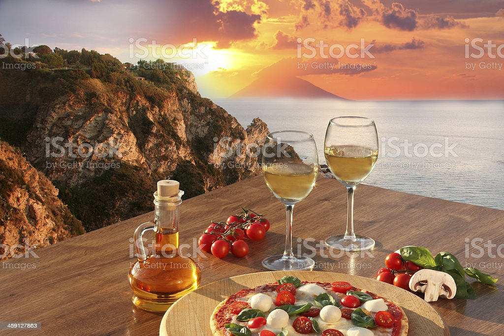 Calabria coast with  Italian pizza and glasses of wine,Italy stock photo